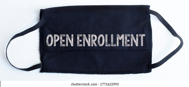 Black disposable protective mask with open enrollment text on black background.