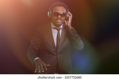 Black DJ in a club at the turntable