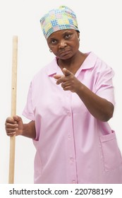Black domestic worker pointing at a person unhappily