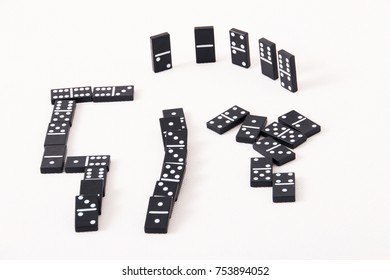 Black domino tiles placed on a white background.