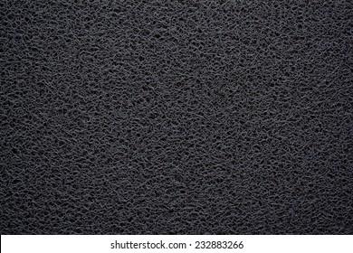 Black doormat texture background.