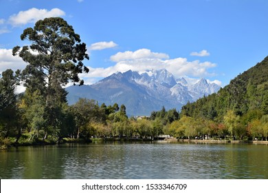 Black Dragon Lagoon in Lijiang, a prefecture-level city in Yunnan province in China is a famous pond in the scenic Jade Spring Park. Jade Dragon Snow Mountain in the background.
