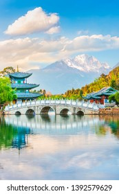 Black Dragon Pond Park. Jade Dragon Snow Mountain, chinese pavilion and bridge. Located in Lijiang, Yunnan, China.