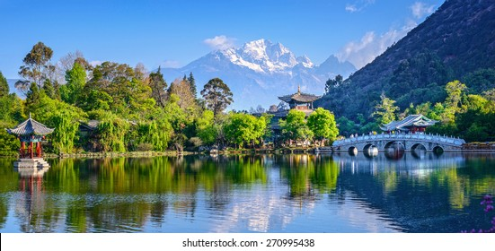 Black Dragon Pool. It's a famous pond in the scenic Jade Spring Park (Yu Quan Park) located at the foot of Elephant Hill, a short walk north of the Old Town of Lijiang in Yunnan province, China.