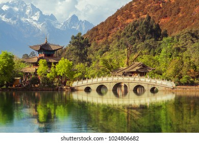Black dragon pool with Jade Dragon Snow mountain. Hei Long tan park in Lijiang. Chinese pagoda in nationnal beautiful park in Yunnan province of China.