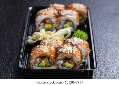 Black dragon roll with unagi in take away container