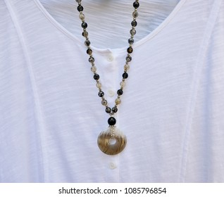 Black Dragon Vein Agate necklace with white shirt