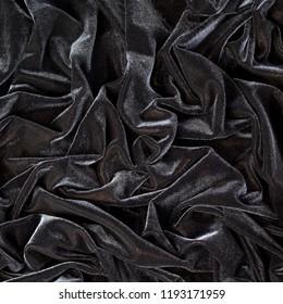 Black drapery closeup background.