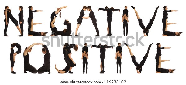Black dressed people forming NEGATIVE and POSITIVE words over white