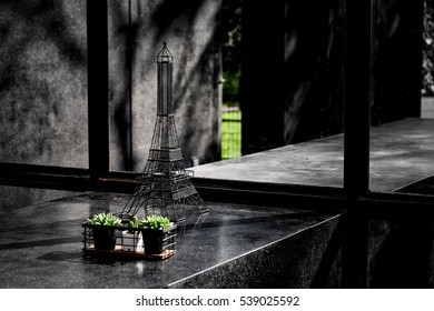 Black Eiffel tower in small imitation in the black theme house