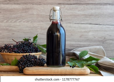 Black elder syrup, berries and leaves