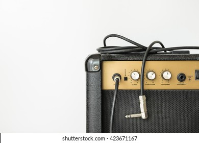 Black electric amplifier with cable on white background