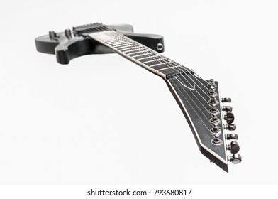 Black electric bass guitar isolated on white background