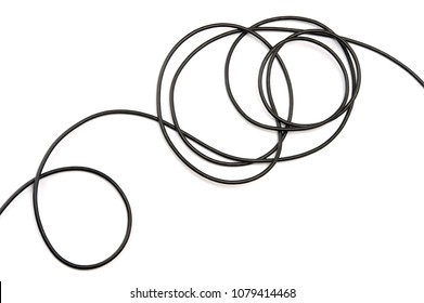 Black electric cable on white background.