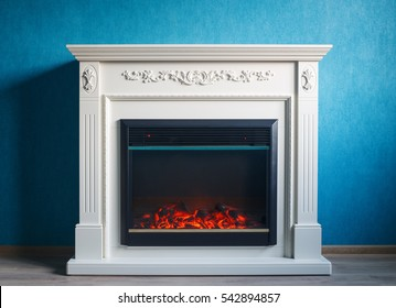 Black electric fireplace with decoration photographed in the interior.