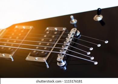 Black electric guitar close up.