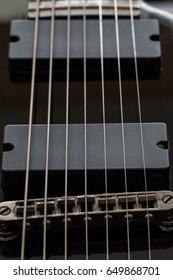 Black electric guitar detail close-up