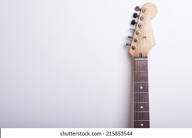 Black electric guitar on white background