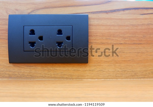 black electrical plugs attached to wooden walls home electricity design of electrical  wiring in the house