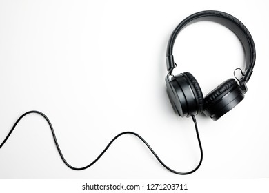 Black electronic headphones isolated on the white background