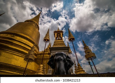 The black elephant stands beside the golden pagoda at Temple of Wat Phra Kaew in Grand Royal Palace.Bangkok ,Thailand