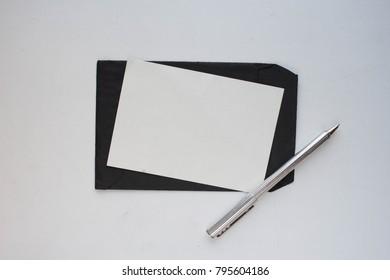 Black envelope  with pen