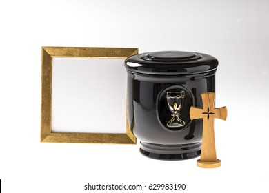 Black evangelical urn with blank mourning frame and crucifix