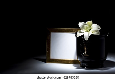 Black evangelical urn with black mourning frame and Lilly