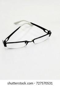 Black Eye Glasses Isolated on White table