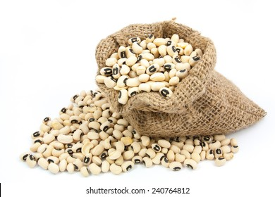 black eyed peas beans in canvas sack on white background