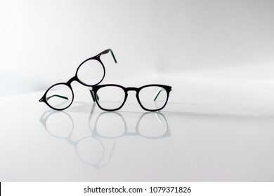 Black Eyeglasses closeup. Eye glasses.Modern style eyeglasses. Round glasses with transparent lenses. Close up eyeglasses with blurry technique. Glasses front view.