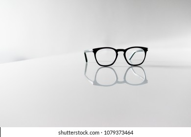 Black Eyeglasses closeup. Eye glasses.Modern style eyeglasses. Round glasses with transparent lenses. Vintage Glasses. Close up eyeglasses with blurry technique.Fashion accessories