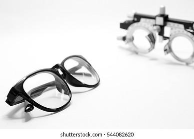 Black eyeglasses with optometrist trial frame on white background