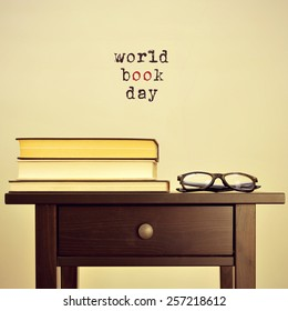 black eyeglasses and some books on a table and the sentence world book day on a beige background, with a retro effect
