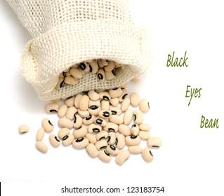 black eyes beans on burlap bag on white background