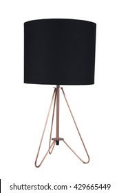 A black fabric and copper tripod table lamp isolated on a white background