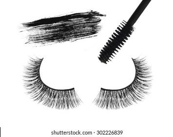 Black false eyelash and mascara isolated on white background