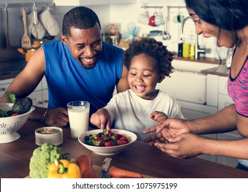 Black family eating healthy food together