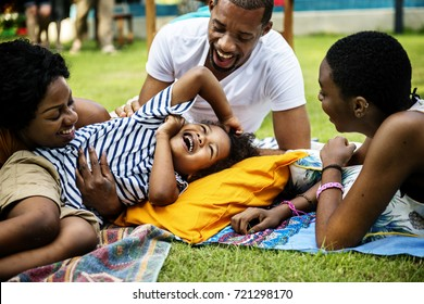 Black family enjoying summer together at backyard