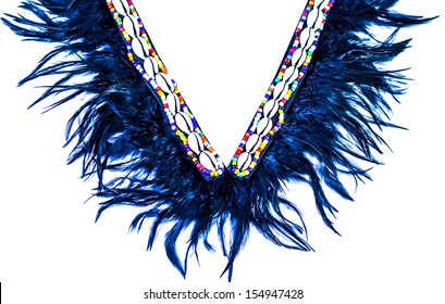 Black feather necklace with beads and shell decoration.