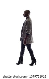 Black female African American model on a white background.  She is walking in side view
