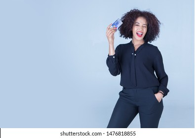 Black female businessmen holding a credit card, standing smile, happy, spending power.