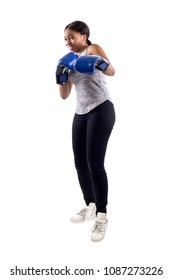 Black female on a white background wearing boxing gloves looking scared.  Part of image set for gritty woman series.