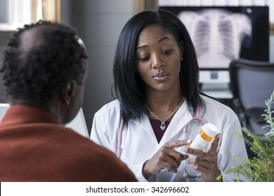 A black female physician prescribing pills to an older black male patient