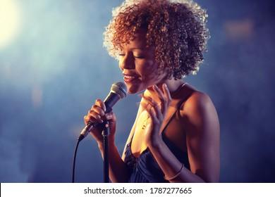 Black female Singer Performing on stage