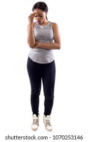 Black female wearing athletic outfit on a white background as a fitness trainer who made a mistake