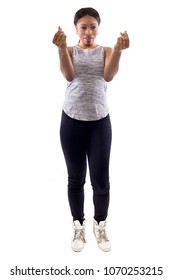 Black female wearing athletic outfit on a white background as a fitness trainer with money gesture