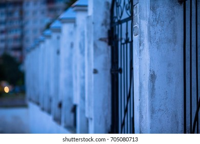black fence with white pillars