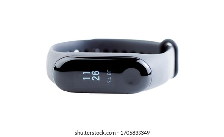 Black fitness bracelet isolated on a white background. Concept of modern gadgets for sports and healthcare. Pedometer A device for the comprehensive measurement of human health while walking.