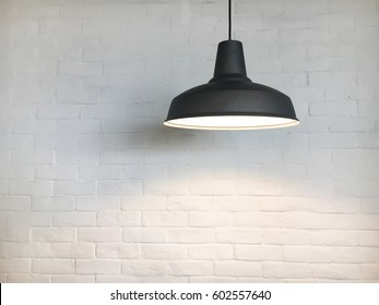 Black fixture and white brick wall.
